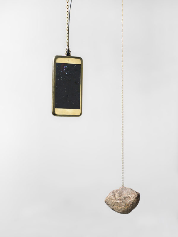 Alicja Kwade, Mini Mobile, 2017 iPhone, stone, chain, motor, dimensions variable, unique Courtesy the artist and KÖNIG GALERIE